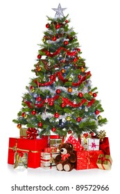 Photo of a Christmas tree with decorations and lights surrounded by presents, isolated on a white background.