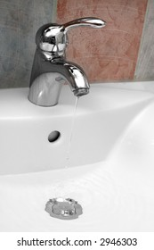 Photo of a chrome metal sink.
