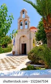 Photo of church in small Cretan town Panormos, Crete, Greece