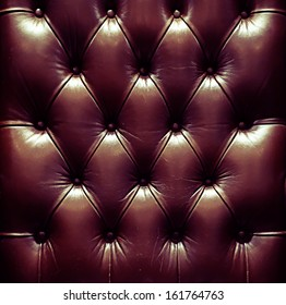 a photo of close up leather upholstery sofa,classic retro