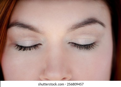 Photo of closed eyes, a beautiful professional make-up,