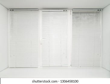 The photo closed window by blinds of white color close up