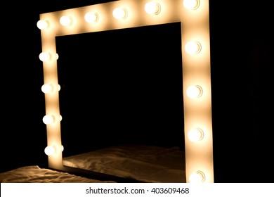 photo of closeup of mirror bulbs at make up room