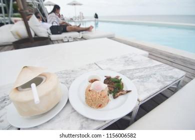 photo of coconut and kapow kai (thai basil chicken) fried egg on top