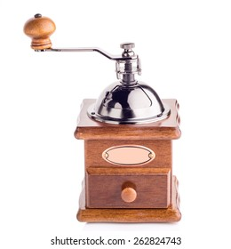 Photo of coffee grinder on a white background.