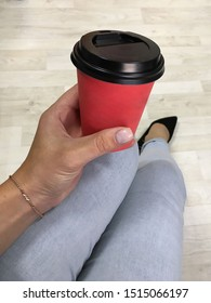 Photo coffee hands, feet, jeans