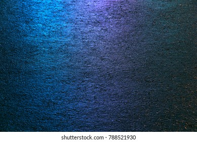 Photo of colored asphalt with blue, purple, green and golen and colors. Texture.