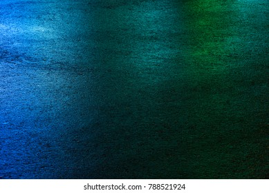 Photo of colored asphalt with green, blue colors. Texture