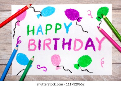 Photo of colorful drawing: Happy Birthday Card on wooden background.