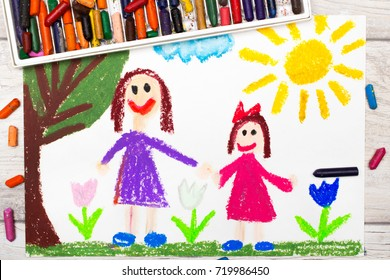 Photo of colorful drawing: Happy single mother with her daughter.