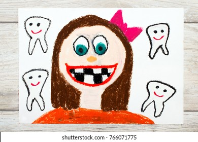 Photo of colorful drawing: Smiling girl without milk teeth.  Losing baby teeth.