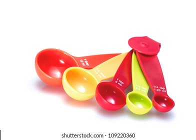 Photo of colorful measuring spoons on a white background