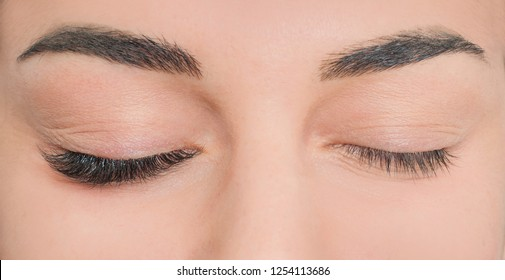 Photo comparison of normal and fake cosmeticly enlarged lashes. Loving beaty procedures in salone. Pretty face.