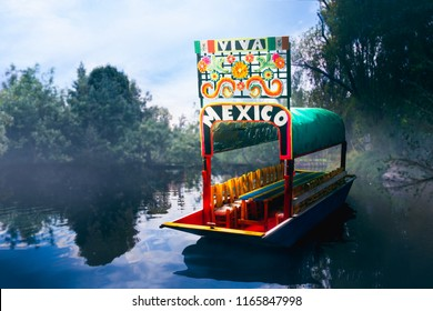 photo composite of a scale model of a mexican trajinera floating on the canal system of Xochimilco