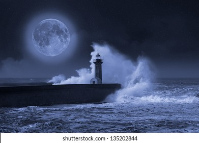 Photo composition of lighthouse with full moon.