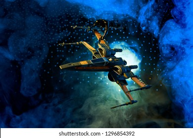 Photo composition of an x-wing fighter battle with first order tie fighter pilot