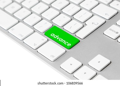 """Photo of a computer keyboard with one green key and the word """"advance"""" symbolising progress and improvement as well as a financial loan."""