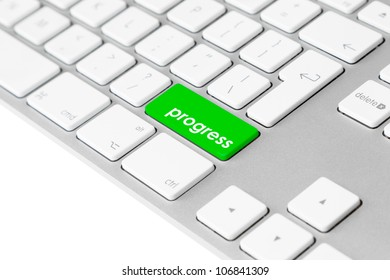 """Photo of a computer keyboard with one green key and the word """"progress"""" symbolising advancement and improvement."""