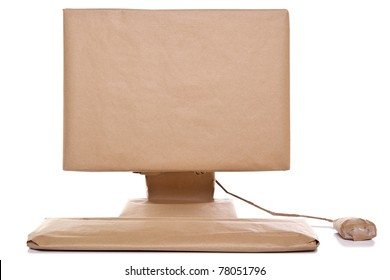 Photo of a computer wrapped in recycled brown paper, isolated on a white background.