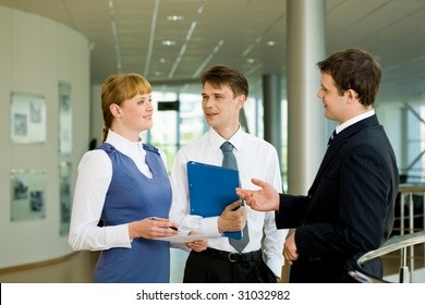 Photo of confident businessteam planning work or consulting each other