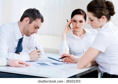 Photo of confident co-workers planning new project at briefing