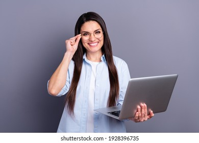 Photo of confident pretty young lady dressed blue shirt arm glasses typing modern gadget isolated grey color background