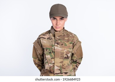 Photo of confident young military girl look attentively camera calm face isolated on white color background