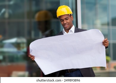 photo of construction engineer with blueprints