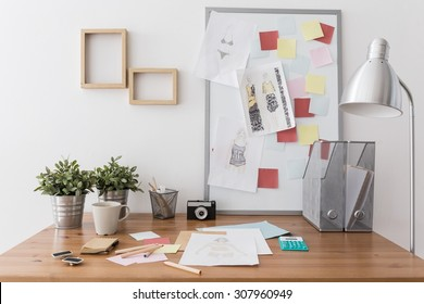 Photo of contemporary creative workplace with office supplies