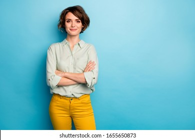 Photo of cool attractive business lady short hairstyle friendly smiling responsible person arms crossed wear casual green shirt yellow pants isolated blue color background - Shutterstock ID 1655650873