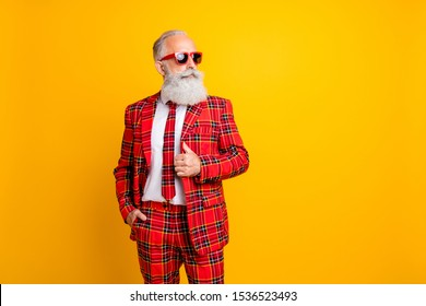 Photo of cool grandpa white beard model guy standing self-confidently posing for magazine cover wear sun specs tartan red costume outfit isolated yellow color background