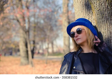photo of cool woman in a black jacket