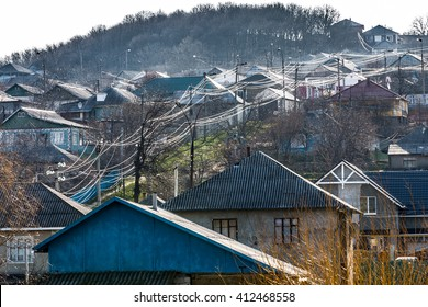 photo of country landscape of third world, power lines in the village