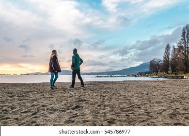 Photo of Couple at English Bay Beach Park in Vancouver, Canada