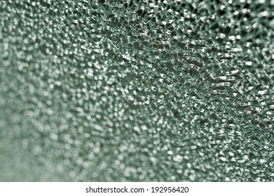 Photo of cracked glass. Perspective view, shallow DOF.