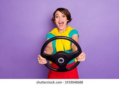 Photo of crazy excited lady open mouth hold steering wheel wear tied pullover t-shirt isolated violet color background