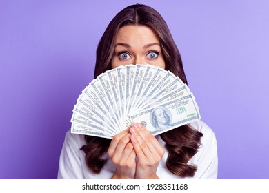 Photo of crazy shy lady hold cash fan hide face look camera wear specs white shirt isolated purple color background