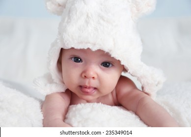 Photo of cute baby girl with white hat