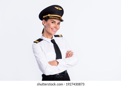 Photo of cute cool pilot lady folded arms look camera wear hat aviator uniform isolated white color background