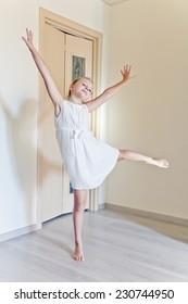 Photo of cute dancing girl in white