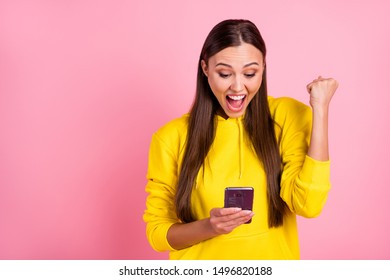 Photo of cute fascinating cheerful casual white model girlfriend rejoicing with someone having reposted her publication wearing yellow sweatshirt hoodie isolated with pink pastel color background