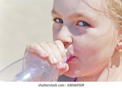 Photo of cute girl with drinking water