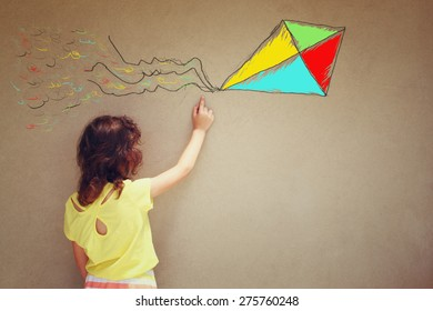 Photo of cute kid imagine flying kite. set of infographics over textured wall background
