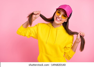 Photo of cute nice charming fascinating sweet lovely girlfriend holding her hands making tails wearing yellow sweater while isolated over pastel color background