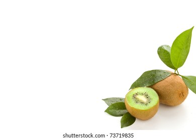 photo of cutted kiwi with green leaves on white isolated background