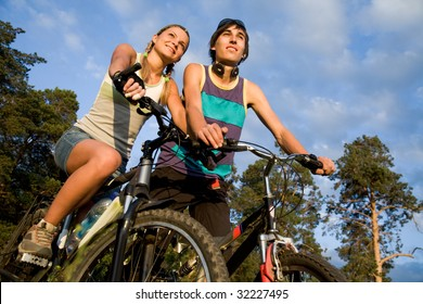 Photo of cyclists on their bikes in park or forest during summer vacations