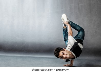 photo of a dancer who is performing extreme break dance movements