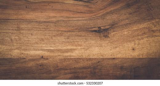 photo of dark brown wooden background texture