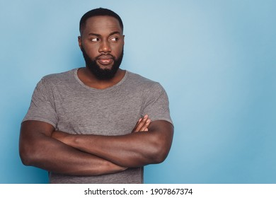 Photo of dark skin guy hold arms crossed look empty space isolated blue background