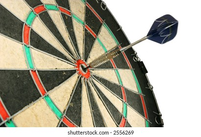 Photo of a dart in the center of the board